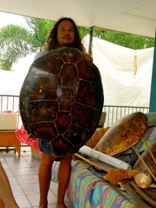Linc demonstrating how large the sea turtles are … it takes a few men to pull them out of the water.