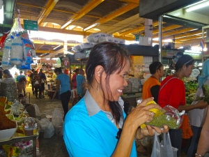 Waida, one of our chefs, explaining the food and spices at the Phuket Town Market.