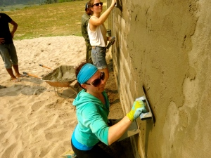 Learning how to cement the walls of our school in Keo Kuang.