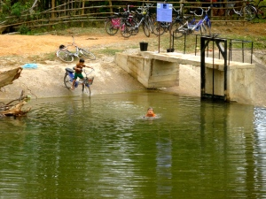 These kids ride their bikes right into the river … both they and the bike get a bath.