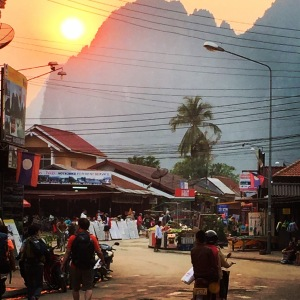 Sunset over the mountains from Vang Vieng town center.