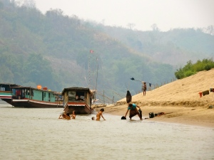 Kids playing by the shores of the Mekong.